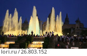 Купить «Evening view at colorful vocal fountain Montjuic show and people watching it nearby in Barcelona.», видеоролик № 26803152, снято 24 июля 2016 г. (c) Яков Филимонов / Фотобанк Лори