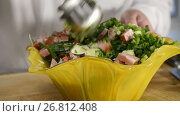 Купить «The cook mixes vegetables and ham salad in beautiful ware», видеоролик № 26812408, снято 26 августа 2017 г. (c) Anatoly Timofeev / Фотобанк Лори