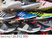 Купить «Counterfeit running shoes on market», фото № 26812900, снято 14 марта 2017 г. (c) Александр Подшивалов / Фотобанк Лори