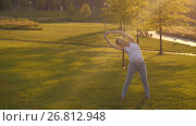 Купить «Pregnant woman doing stretching exercises», видеоролик № 26812948, снято 19 августа 2017 г. (c) Илья Шаматура / Фотобанк Лори