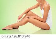 Купить «woman with safety razor shaving legs», фото № 26813940, снято 9 апреля 2017 г. (c) Syda Productions / Фотобанк Лори