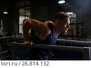Купить «man doing triceps dip on parallel bars in gym», фото № 26814132, снято 2 июля 2017 г. (c) Syda Productions / Фотобанк Лори
