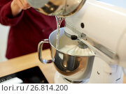 Купить «chef pouring ingredient from pot into mixer bowl», фото № 26814200, снято 8 мая 2017 г. (c) Syda Productions / Фотобанк Лори