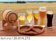 Купить «beer glasses, barrel and pretzel over cereal field», фото № 26814272, снято 22 июля 2016 г. (c) Syda Productions / Фотобанк Лори