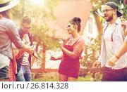 happy friends dancing at summer party in garden. Стоковое фото, фотограф Syda Productions / Фотобанк Лори