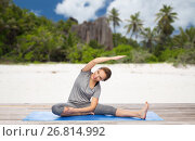 Купить «happy woman doing yoga and stretching on beach», фото № 26814992, снято 13 ноября 2015 г. (c) Syda Productions / Фотобанк Лори