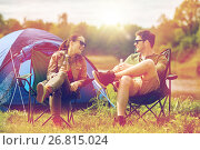 Купить «happy couple drinking beer at campsite tent», фото № 26815024, снято 27 мая 2016 г. (c) Syda Productions / Фотобанк Лори