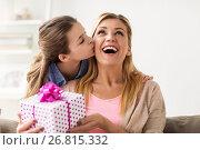 Купить «girl giving birthday present to mother at home», фото № 26815332, снято 26 марта 2017 г. (c) Syda Productions / Фотобанк Лори