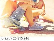Купить «teenage couple with skateboards on city street», фото № 26815916, снято 19 июля 2016 г. (c) Syda Productions / Фотобанк Лори