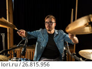 Купить «male musician playing drums and cymbals at concert», фото № 26815956, снято 18 августа 2016 г. (c) Syda Productions / Фотобанк Лори
