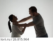 Купить «couple having fight and man choking woman», фото № 26815964, снято 20 января 2017 г. (c) Syda Productions / Фотобанк Лори