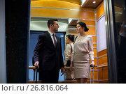 Купить «business team with travel bags in hotel elevator», фото № 26816064, снято 22 мая 2017 г. (c) Syda Productions / Фотобанк Лори