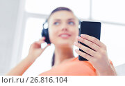 Купить «woman with headphones and smartphone at home», фото № 26816104, снято 1 июня 2013 г. (c) Syda Productions / Фотобанк Лори