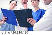 Купить «close up of doctors with clipboard at hospital», фото № 26816120, снято 3 декабря 2015 г. (c) Syda Productions / Фотобанк Лори