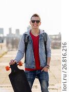 Купить «happy young man or teenage boy with longboard», фото № 26816216, снято 19 марта 2015 г. (c) Syda Productions / Фотобанк Лори