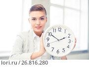 Купить «attractive businesswoman showing white clock», фото № 26816280, снято 1 июня 2013 г. (c) Syda Productions / Фотобанк Лори