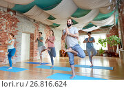 Купить «group of people doing yoga tree pose at studio», фото № 26816624, снято 5 марта 2017 г. (c) Syda Productions / Фотобанк Лори