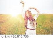 Купить «smiling young hippie woman on cereal field», фото № 26816736, снято 27 августа 2015 г. (c) Syda Productions / Фотобанк Лори