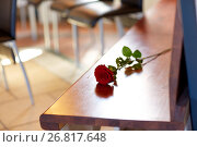 Купить «red roses on bench at funeral in church», фото № 26817648, снято 20 марта 2017 г. (c) Syda Productions / Фотобанк Лори