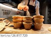 Купить «baker with baskets for dough rising at bakery», фото № 26817720, снято 15 мая 2017 г. (c) Syda Productions / Фотобанк Лори