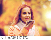 Купить «woman recording voice on smartphone in autumn park», фото № 26817872, снято 6 октября 2016 г. (c) Syda Productions / Фотобанк Лори