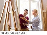 Купить «artists with palette and easel at art school», фото № 26817956, снято 26 мая 2017 г. (c) Syda Productions / Фотобанк Лори