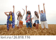 Купить «happy young hippie friends dancing on cereal field», фото № 26818116, снято 27 августа 2015 г. (c) Syda Productions / Фотобанк Лори