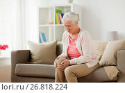 Купить «senior woman suffering from pain in leg at home», фото № 26818224, снято 20 июня 2017 г. (c) Syda Productions / Фотобанк Лори