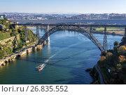 Купить «View from Infante D. Henrique Bridge on a Maria Pia Bridge old railway bridge over Douro river between Porto (L) and Vila Nova de Gaia, Portugal.», фото № 26835552, снято 11 декабря 2016 г. (c) easy Fotostock / Фотобанк Лори