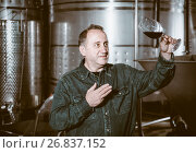 Купить «Worker of winery costs with glass of red wine near tanks», фото № 26837152, снято 12 октября 2016 г. (c) Яков Филимонов / Фотобанк Лори
