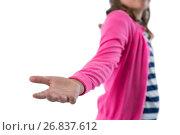 Купить «Mid section of girl pretending to be holding invisible object», фото № 26837612, снято 24 января 2017 г. (c) Wavebreak Media / Фотобанк Лори