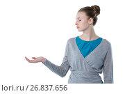 Купить «Teenage girl pretending to hold invisible object», фото № 26837656, снято 24 января 2017 г. (c) Wavebreak Media / Фотобанк Лори