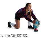 Купить «Full length of young female athlete keeping rugby ball on tee», фото № 26837932, снято 26 апреля 2017 г. (c) Wavebreak Media / Фотобанк Лори