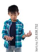 Купить «Boy pretending to hold invisible object», фото № 26838732, снято 24 января 2017 г. (c) Wavebreak Media / Фотобанк Лори