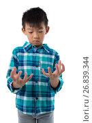 Купить «Boy pretending to hold invisible object», фото № 26839344, снято 24 января 2017 г. (c) Wavebreak Media / Фотобанк Лори