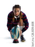 Купить «Portrait of female athlete keeping rugby ball on tee», фото № 26839608, снято 26 апреля 2017 г. (c) Wavebreak Media / Фотобанк Лори