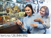 Купить «Cheerful female friends selecting fine chocolates and confectionery», фото № 26844992, снято 22 сентября 2018 г. (c) Яков Филимонов / Фотобанк Лори
