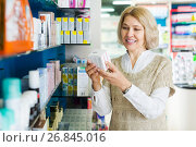 Купить «Female near counter in pharmacy», фото № 26845016, снято 16 августа 2018 г. (c) Яков Филимонов / Фотобанк Лори