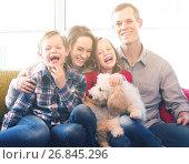 Купить «cheerful parents and children happy to spend time at home», фото № 26845296, снято 20 июня 2019 г. (c) Яков Филимонов / Фотобанк Лори