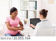 Купить «gynecologist doctor and pregnant woman at hospital», фото № 26855164, снято 4 августа 2017 г. (c) Syda Productions / Фотобанк Лори