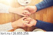 Купить «close up of couple holding hands at restaurant», фото № 26855256, снято 23 января 2016 г. (c) Syda Productions / Фотобанк Лори