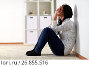 unhappy woman crying on floor at home. Стоковое фото, фотограф Syda Productions / Фотобанк Лори