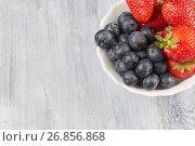 Berries on a gray wooden background. Стоковое фото, фотограф Алексей Спирин / Фотобанк Лори