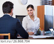 Купить «agent listening to customer and smiling in agency», фото № 26868704, снято 20 июля 2018 г. (c) Яков Филимонов / Фотобанк Лори