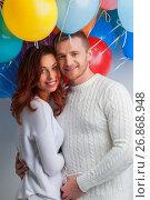 Купить «Couple with balloons», фото № 26868948, снято 15 декабря 2016 г. (c) Иван Михайлов / Фотобанк Лори