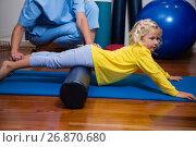 Купить «Physiotherapist giving physical therapy to the girl», фото № 26870680, снято 23 апреля 2017 г. (c) Wavebreak Media / Фотобанк Лори