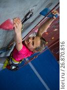 Купить «Portrait of teenage girl practicing rock climbing», фото № 26870816, снято 10 мая 2017 г. (c) Wavebreak Media / Фотобанк Лори