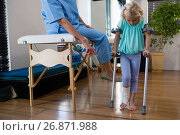 Купить «Physiotherapist assisting girl patient to walk with crutches», фото № 26871988, снято 23 апреля 2017 г. (c) Wavebreak Media / Фотобанк Лори