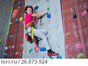 Купить «Portrait of confident teenage girl practicing rock climbing», фото № 26873924, снято 10 мая 2017 г. (c) Wavebreak Media / Фотобанк Лори