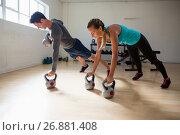 Купить «Athletes doing pushups with kettlebells in gym», фото № 26881408, снято 10 мая 2017 г. (c) Wavebreak Media / Фотобанк Лори